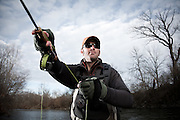 Fly Fishing Guide Ron Lewis of Ohio Trophy Trout Hunter casts a streamer on the Mad River in Ohio.