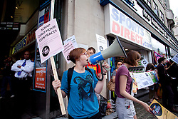 © Licensed to London News Pictures . 03/08/2013 . London, UK.  Youth Fight for Jobs campaigners protest against the use of 'zero hour' contracts by the high street retailer Sports Direct in Oxford Street Plaza, London. Photo credit : /LNP