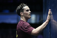 Paul Coll of New Zealand (wearing a Maroon shirt) wipes his sweat on the wall. Canary Wharf Squash Classic 2016 , day two at the East Wintergarden in Canary Wharf , London on Tuesday 8th March 2016.<br /> pic by John Patrick Fletcher, Andrew Orchard sports photography.