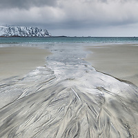 Natural patterns in the sand form a path to the cold Norwegian Sea.