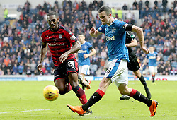 Rangers' Jamie Murphy (right) and Dundee's Roarie Deacon battle for ball during the Ladbrokes Scottish Premiership match at the Ibrox Stadium, Glasgow.
