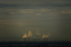 © Licensed to London News Pictures . 07/12/2013 . Fiddlers Ferry coal fired and biomass power station in Cuerdley , Cheshire , as viewed from Manchester . Photo credit : Joel Goodman/LNP