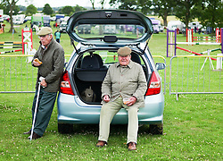 © Licensed to London News Pictures.29/07/15<br /> Borrowby, UK. <br /> <br /> Two men have their lunch at the back of their car at the Borrowby Country Show and Gymkhana in North Yorkshire.<br /> <br /> Photo credit : Ian Forsyth/LNP