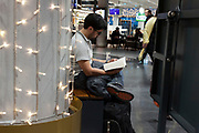 person reading while waiting in the Frankfurt airport