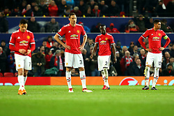 Manchester United players cut dejected figures after conceding a goal to Sevilla - Mandatory by-line: Robbie Stephenson/JMP - 13/03/2018 - FOOTBALL - Old Trafford - Manchester, England - Manchester United v Sevilla - UEFA Champions League Round of 16 2nd Leg