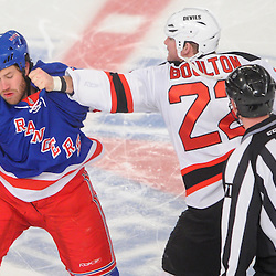 New Jersey Devils left wing Eric Boulton (22) fights New York Rangers right wing Brandon Prust (8) during first period NHL action between the New Jersey Devils and the New York Rangers at Madison Square Garden in New York, N.Y.