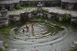 August 1, 2018 - Kathmandu, Nepal - Boys swim in rainwater inside an ancient water spout in Kathmandu, Nepal. (Credit Image: © Skanda Gautam via ZUMA Wire)