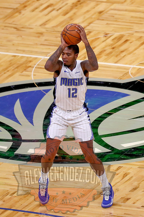 ORLANDO, FL - FEBRUARY 17:   Gary Clark #12 of the Orlando Magic attempts a shot against the New York Knicks at Amway Center on February 17, 2021 in Orlando, Florida. NOTE TO USER: User expressly acknowledges and agrees that, by downloading and or using this photograph, User is consenting to the terms and conditions of the Getty Images License Agreement. (Photo by Alex Menendez/Getty Images)*** Local Caption *** Gary Clark