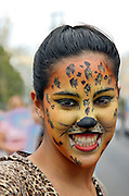 young woman made up to look like a tiger