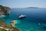 A luxury yacht moored off the scenic west coast of Paxos, The Ionian Islands, Greece, Europe