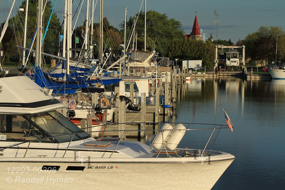 Reflections accent yacht marina on a September afternoon in Alpena, Michigan.