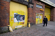 As the third national coronavirus lockdown continues, some people are still out and about but the streets remain very empty, and shops remain closed like this second hand clothing shop in Digbeth on 18th January 2021 in Birmingham, United Kingdom. Following the recent surge in cases including the new variant of Covid-19, this nationwide lockdown, which is an effective Tier Five, advises all citizens to follow the message to stay at home, protect the NHS and save lives.