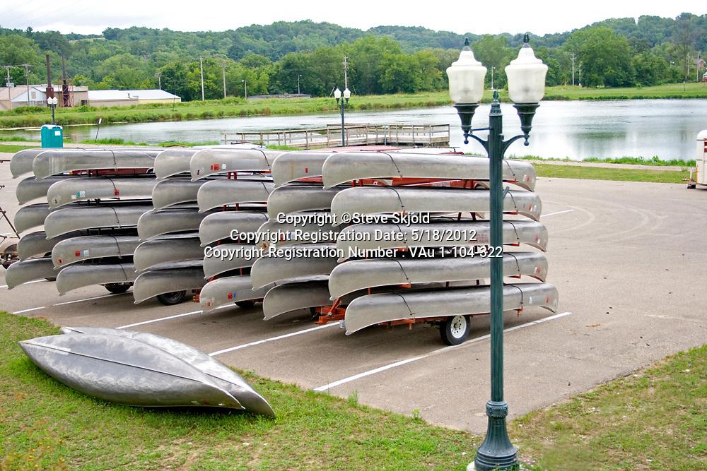 Racks of aluminum canoes ready for paddling down the Root River.  Lanesboro Minnesota MN USA