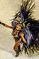Samba dancer in the Carnaval parade of GRES Sao Clemente samba school in the Sambadrome, Rio de Janeiro, Brazil.