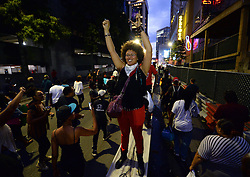 September 21, 2016 - Charlotte, NC, USA - A protestor cheers others as they march to the Epicentre in Charlotte, N.C., on Wednesday, Sept. 21, 2016. The protestors were rallying against the fatal shooting of Keith Lamont Scott by police on Tuesday evening in the University City area. (Credit Image: © Jeff Siner/TNS via ZUMA Wire)