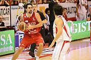 DESCRIZIONE : Pistoia Lega serie A 2013/14  Giorgio Tesi Group Pistoia Pesaro<br /> GIOCATORE : Musso Bernardo<br /> CATEGORIA : palleggio<br /> SQUADRA : Pesaro Basket<br /> EVENTO : Campionato Lega Serie A 2013-2014<br /> GARA : Giorgio Tesi Group Pistoia Pesaro Basket<br /> DATA : 24/11/2013<br /> SPORT : Pallacanestro<br /> AUTORE : Agenzia Ciamillo-Castoria/M.Greco<br /> Galleria : Lega Seria A 2013-2014<br /> Fotonotizia : Pistoia  Lega serie A 2013/14 Giorgio  Tesi Group Pistoia Pesaro Basket<br /> Predefinita :