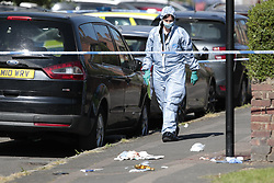 © Licensed to London News Pictures. 11/06/2018. London, UK. A police forensics officer is seen where a 17 year old was critically injured in a stabbing in Harrow last night.Police are also dealing with a stabbing incident in nearby Northolt where a 20 year old was injured. Photo credit: Peter Macdiarmid/LNP  Photo credit: Peter Macdiarmid/LNP