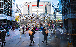 Glasgow, Scotland, UK. 19 November 2020. On the day before the highest level 4 lockdown is imposed on west and central Scotland, shops in Glasgow city centre and streets are busy with members of the public. Pictured; Shoppers on Argyle Street.  Iain Masterton/Alamy Live News
