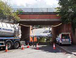 © Licensed to London News Pictures. 25/08/2020. London, UK. Engineers at the scene of a Flood on Stag Lane underpass on the A3 in Roehampton,  South West London as the Met Office issue a yellow weather warning for Storm Francis with winds in excess of 50mph and heavy rain for most of the country which could lead to potential travel disruption and damage to trees. Photo credit: Alex Lentati/LNP
