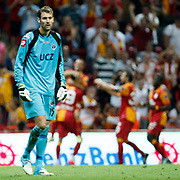 Galatasaray's players celebrating his goal and Kasimpasa's goalkeeper Andreas Isaksson (L) during their Turkish Super League soccer match Galatasaray between Kasimpasa at the TT Arena at Seyrantepe in Istanbul Turkey on Monday 20 August 2012. Photo by TURKPIX