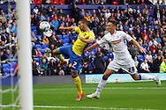 Exeter City's Liam Sercombe looks to shoot while under pressure from Tranmere Rovers' Ben Davies. Skybet football league two match, Tranmere Rovers v Exeter city at Prenton Park in Birkenhead, the Wirral on Saturday 20th Sept 2014.<br /> pic by Chris Stading, Andrew Orchard sports photography.