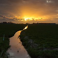 Zonsondergang landerijen bij Hommerts