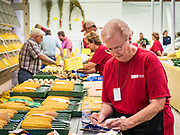 08 AUGUST 2019 - DES MOINES, IOWA: A volunteer sets up the field corn display at the agriculture building at the Iowa State Fair. The Iowa State Fair is one of the largest state fairs in the U.S. More than one million people usually visit the fair during its ten day run. The 2019 fair run from August 8 to 18.           PHOTO BY JACK KURTZ