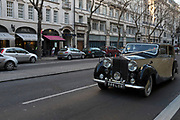 Vintage Rolls Royce, driving through Holborn in London, UK.