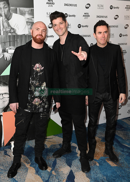 Mark Sheehan (left), Danny O'Donoghue (centre) and Glen Power from The Script arriving for the 26th Annual Music Industry Trusts Awards held at the Grosvenor House Hotel, London. Picture credit should read: Doug Peters/Empics Entertainment