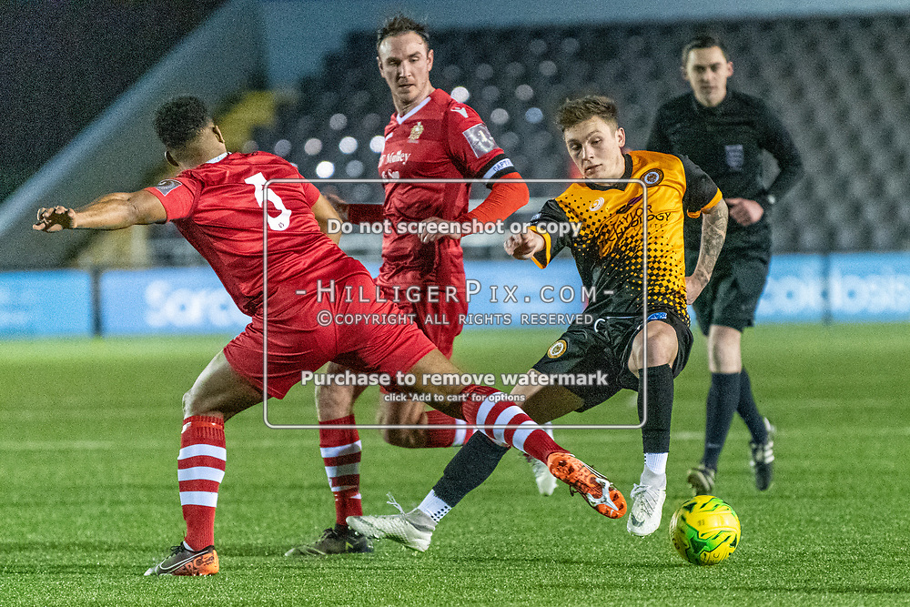 BROMLEY, UK - JANUARY 15: Joel Rollinson,  of Cray Wanderers FC, tries to step out of a challenge by Rickie Hayles, of Hornchurch, during the BetVictor Isthmian Premier League match between Cray Wanderers and Hornchurch at Hayes Lane on January 15, 2020 in Bromley, UK. <br /> (Photo: Jon Hilliger)