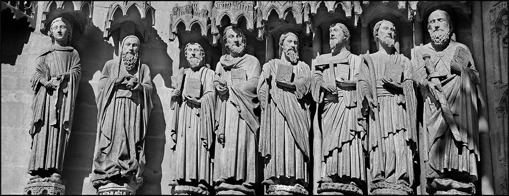 Sacred Stone - Black and white photo art print of Gothic statues of the Cathedral of Notre-Dame Amiens by Paul Williams. Gothic statues of an  array of saints.  Gothic Cathedral of Notre-Dame, Amiens, France .<br /> <br /> Visit our LANDSCAPE PHOTO ART PRINT COLLECTIONS for more wall art photos to browse https://funkystock.photoshelter.com/gallery-collection/Places-Landscape-Photo-art-Prints-by-Photographer-Paul-Williams/C00001WetsxVxNTo