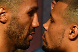 James Degale and Chris Eubank Jr during the weigh in at the The O2, London.