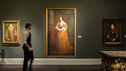 """© Licensed to London News Pictures. 04/12/2015. London, UK. (L to R) """"Portrait of Henry VIII"""" by Hans Holbein (est. £0.8-1.2 million), """"Portrait of Queen Henrietta Maria"""" by Sir Anthony Van Dyck (est. £1.5-2.0 million), """"Portrait of a man, said to be Raphael Raggio, half-length in armour"""" by Sir Anthony Van Dyck (est. £0.4-0.6 million) ahead of Sotheby's London evening sale of Old Master and British paintings on 9th December 2015.  Photo credit : Stephen Chung/LNP"""