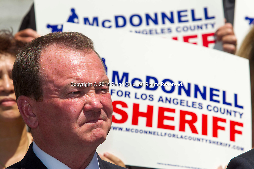 Los Angeles Mayor Eric Garcetti officially endorses Long Beach Police Chief Jim McDonnell for Los Angeles County Sheriff during a press conference on Tuesday, September 9, 2014 in Los Angeles.<br />  (Photo by Ringo Chiu/PHOTOFORMULA.com)