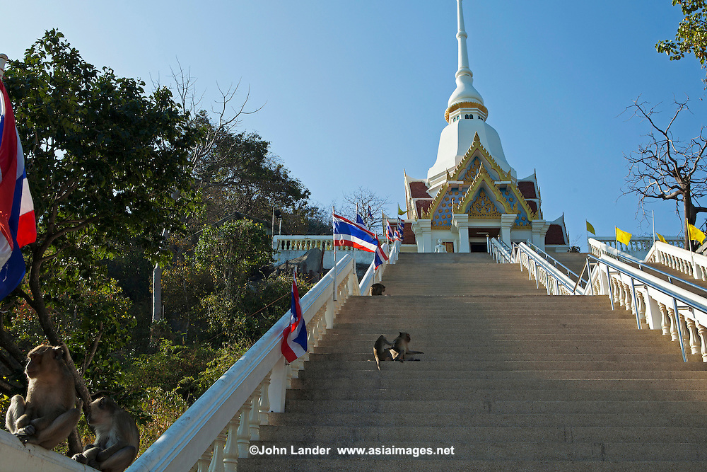 """Wat Khao Takiab is situated on a rocky promontory south of Hua Hin by a small picturesque fishing village. Khao Takiab is also know as """"Monkey Mountain"""" due to large numbers of monkeys macaques that are resident there. While not really fierce care should be taken when they are around as they have a habit of grabbing and making off with anything that takes their fancy."""