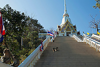 "Wat Khao Takiab is situated on a rocky promontory south of Hua Hin by a small picturesque fishing village. Khao Takiab is also know as ""Monkey Mountain"" due to large numbers of monkeys macaques that are resident there. While not really fierce care should be taken when they are around as they have a habit of grabbing and making off with anything that takes their fancy."