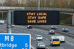 Glasgow,Scotland, UK. 2 November 2020. Motorists pass motorway gantry with Covid-19 health advisory message on the M8 in Glasgow as Scotland enters new Coronavirus lockdown regulations  with the central belt and Glasgow placed in Level 3. Iain Masterton/Alamy Live News