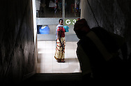 A woman pauses on a stairwell landing at the Bugando Medical Center in Mwanza, Tanzania on Wednesday, September 3, 2014.  © Chet Gordon for AmeriCares.