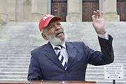 1/14/15  Jackson, MS- Civil rights icon and Mississippi Native, James Meredith delivers his message on the steps of the Mississippi State Capital on MLK's birthday. Meredith was also a given a standing ovation by the legislature , while he was a spectator in the gallery before his press conference on the steps of the State Capital. Photo © Suzi Altman