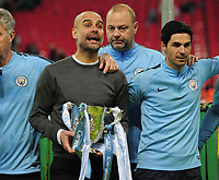 Football - 2019 EFL League Cup Final (Carabao Cup) - Manchester City vs. Chelsea<br /> <br /> Man City manager, Pep Guardiola with the trophy and Mikel Arteta (coach), at Wembley Stadium.<br /> <br /> COLORSPORT/ANDREW COWIE