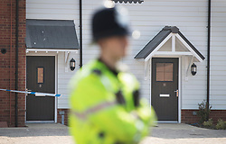 © Licensed to London News Pictures. 04/07/2018. Amesbury, UK. A police officer stands outside a property in Muggleton Road in Amesbury after a couple named locally as Dawn Sturgess, 44, and her partner Charlie Rowley, 45, were taken ill on Saturday 30th June 2018. Police have confirmed that the couple have been in contact with Novichok nerve agent. Former Russian spy Sergei Skripal and his daughter Yulia were poisoned with Novichok nerve agent in nearby Salisbury in March 2018.Photo credit: Peter Macdiarmid/LNP