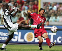 Fotball<br /> Serie A Italia<br /> Foto: Graffiti/Digitalsport<br /> NORWAY ONLY<br /> <br /> Livorno 22/5/2005 Campionato Italiano Serie A <br /> Livorno Juventus 2-2<br /> <br /> Livorno Igor Protti - He was top goalscorer in A, B and C series. Probably he will retire from football at the end of this season. <br /> In this picture Igor Protti challenged by Juventus Stephen Appiah