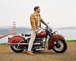 Man on a motorcycle looking out over the San Francisco Bay