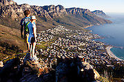 Hikers enjoy the view from the summit of Lions Head looking out across the Atlantic Ocean and the Twelve Apostles. Image by Greg Beadle