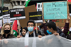 London, UK. 22nd May, 2021. Tens of thousands of people take part in a National Demonstration for Palestine from Victoria Embankment to Hyde Park. It was organised by pro-Palestinian solidarity groups in protest against Israel's recent attacks on Gaza, its incursions at the Al-Aqsa mosque and its attempts to forcibly displace Palestinian families from the Sheikh Jarrah neighbourhood of East Jerusalem.