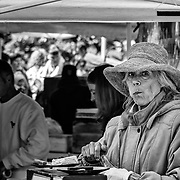 On Saturdays there is a farmers market in Patriots Park.  This lady was clearly enjoying the wares she was selling.  I love the eyes showing out from under that big hat.