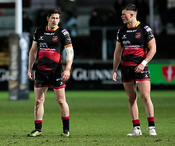 Dragons' Sam Beard with team-mate Jared Rosser<br /> <br /> Photographer Simon King/Replay Images<br /> <br /> Guinness Pro14 Round 12 - Dragons v Cardiff Blues - Sunday 31st December 2017 - Rodney Parade - Newport<br /> <br /> World Copyright © 2017 Replay Images. All rights reserved. info@replayimages.co.uk - http://replayimages.co.uk