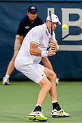 USA's John Isner hits a return against India's Somdev Dewarman during their men's singles match at the Citi Open ATP tennis tournament in Washington, DC, USA, 1 Aug 2013. Isner won the match 7-5, 7-5 to advance.
