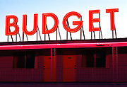 Budget hotel sign glowing red after sunset