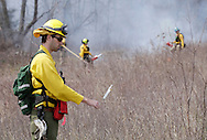 Burn crew member Luke Pettinga of Michigan takes weather readings during a prescribed burn at Glory Hill on the Mohonk Preserve on Thursday, April 16, 2009. Wind speed and direction, humidity and temperature are among the variables measure before and during the burn.